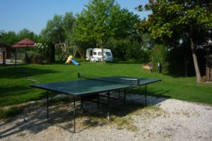 Table Tennis with camping ground in the back.